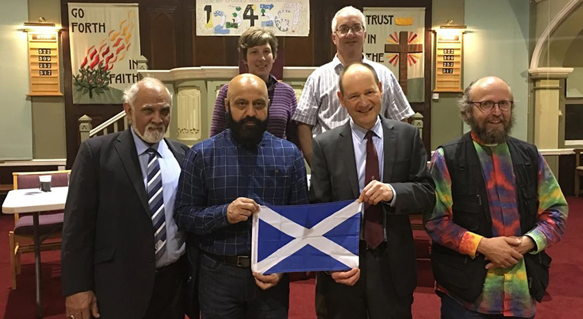 Interfaith Scotland group photo with Scottish flag