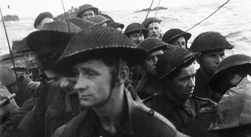 Film still from the D Day landings showing commandos aboard a landing craft on their approach to Sword Beach 6 June 1944. BU1181 credit wikimedia