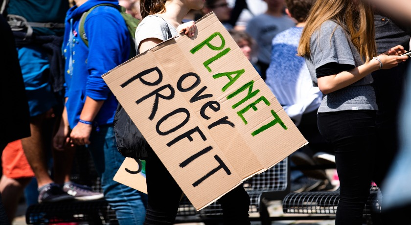 Planet over profit sign credit Markus Spiske on Unsplash
