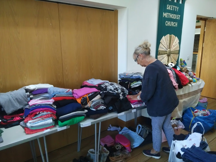 UiD trustee at the clothing bank