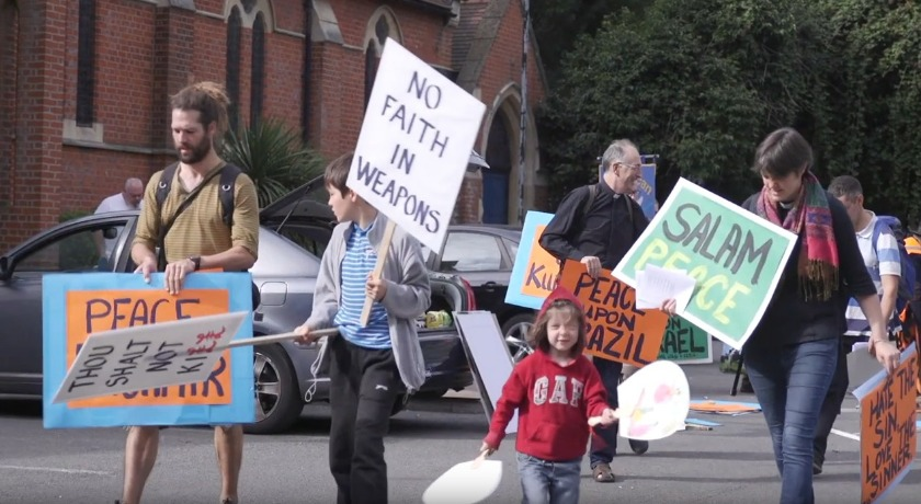 arms fair protestors news banner
