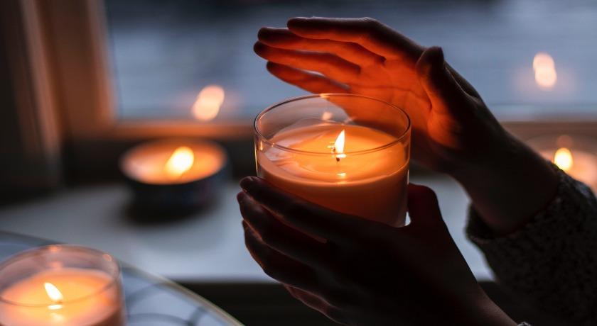 candle by rebecca petterson unsplash