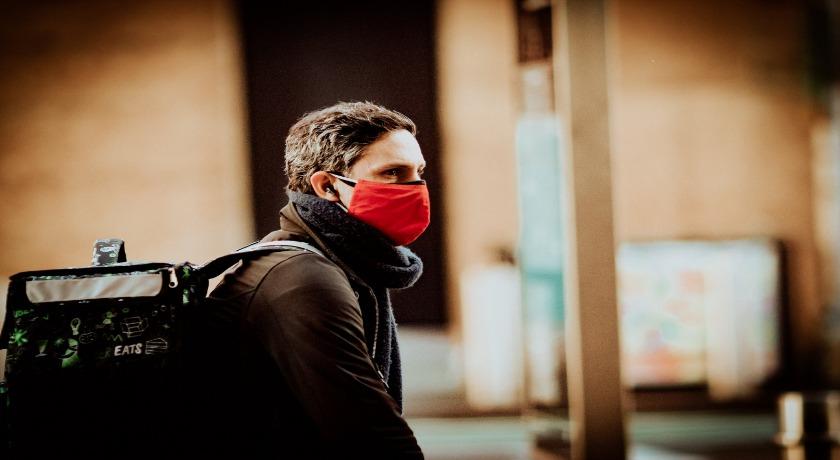man wearing a mask credit Jon Tyson Unsplash