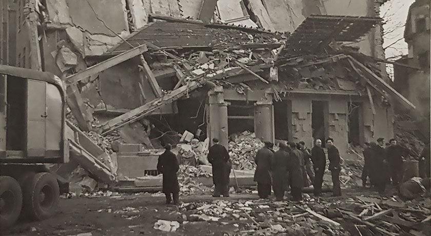 people gathered to inspect bomb damage